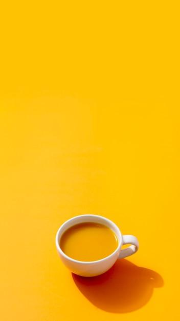 Fresh smoothie on yellow background Premium Photo