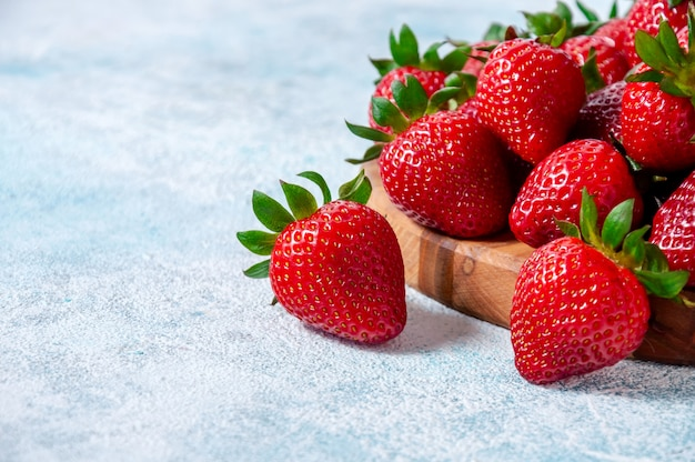 Fresh strawberries on wooden board. Premium Photo