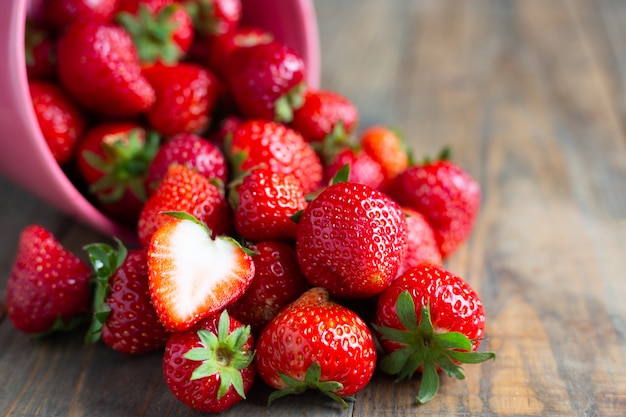Fresh strawberries on wooden table. Free Photo