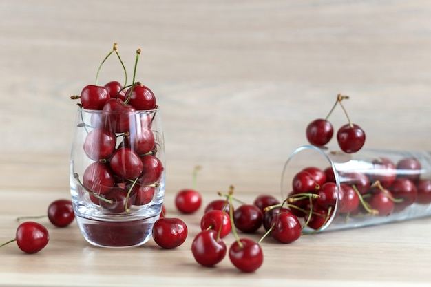 Fresh sweet cherry in a glass on a table. Premium Photo