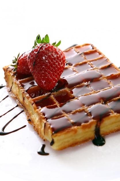 Fresh sweet chocolate waffles with strawberry Free Photo
