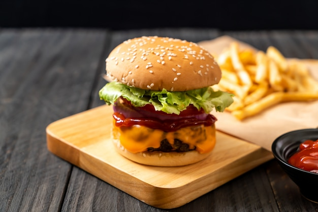Fresh tasty beef burger with cheese and ketchup Premium Photo