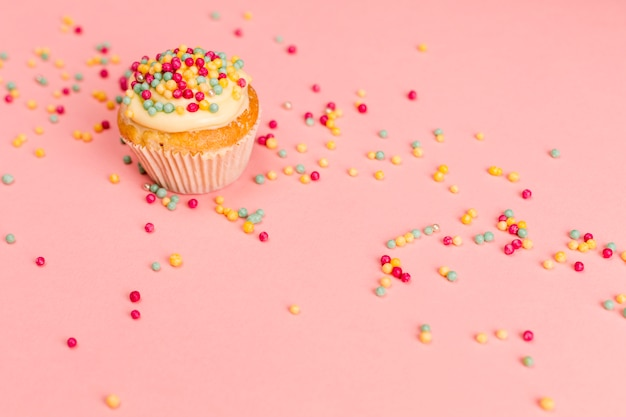 Fresh tasty cupcake with sprinkles Free Photo