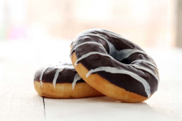 Fresh tasty donuts with brown glaze Free Photo