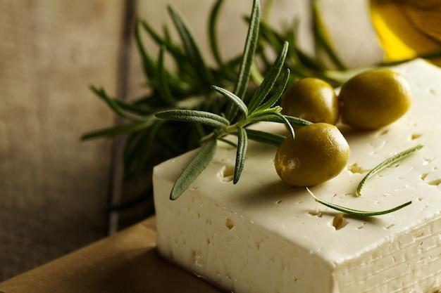 Fresh tasty greek green olives with cheese feta or goat cheese. closeup. mediterranean food.horizontal. Free Photo