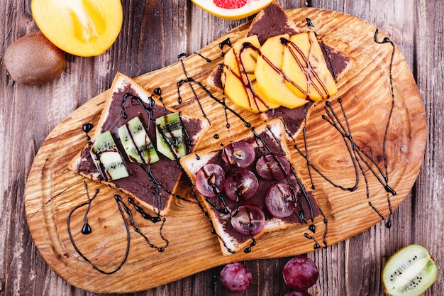 Fresh, tasty and healthy food. lunch or breakfast ideas. bread with chocolate butter, grape Free Photo