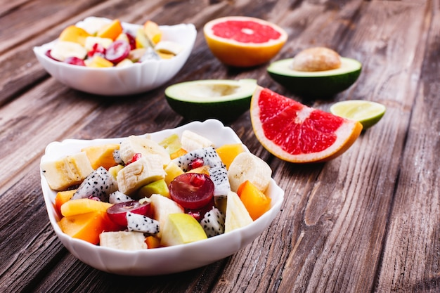Fresh, tasty and healthy food. lunch or breakfast ideas. salad of dragon fruit, grape, apple Free Photo