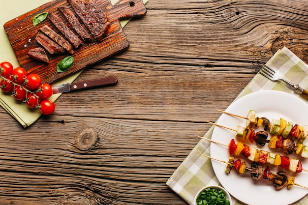 Fresh tasty meat and steak on wooden surface Free Photo