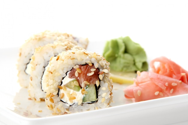 A fresh and tasty sushi roll Free Photo