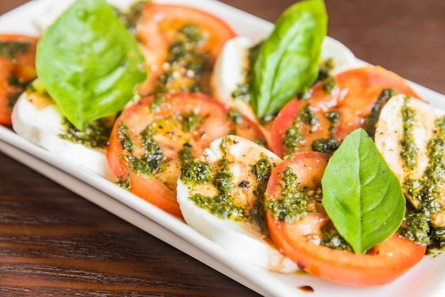 Fresh tomato mozzarella cheese Free Photo