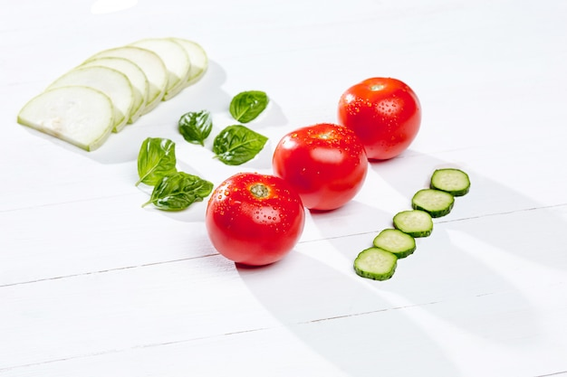 Fresh tomatoes and cucumber slices Free Photo