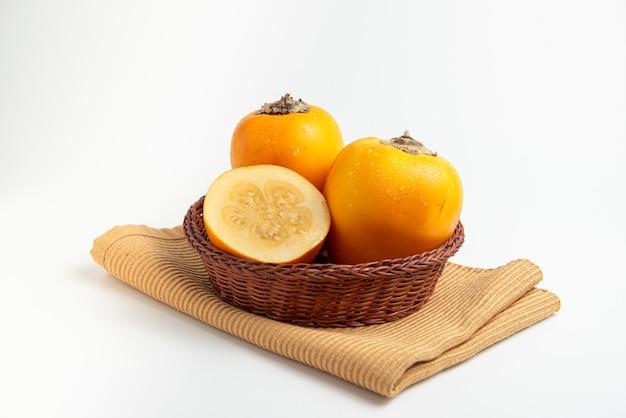 Fresh tropical fruit in a rustic bowl cocona Premium Photo