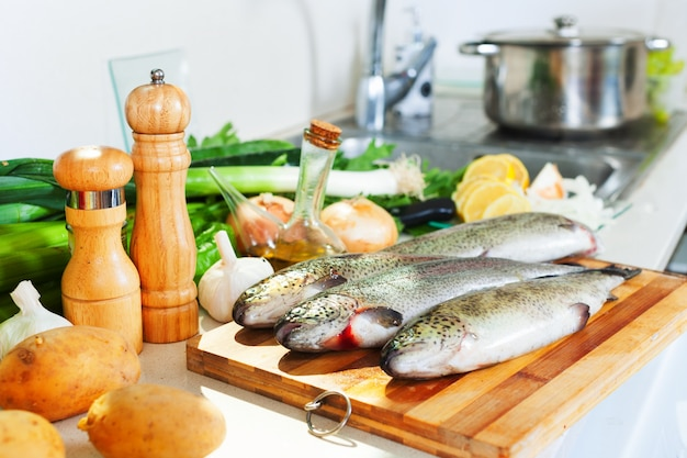 Fresh trout  in kitchen Free Photo