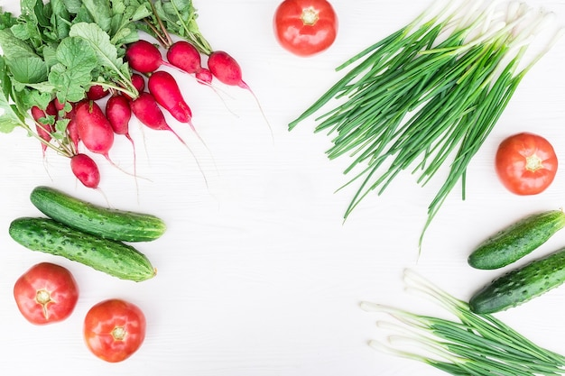 Fresh vegetables from the garden frame background Premium Photo