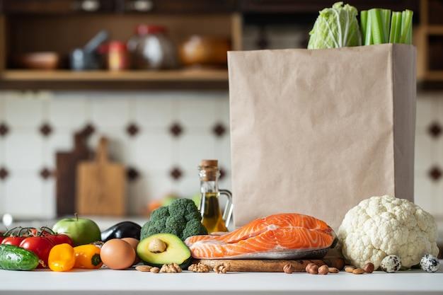 Fresh vegetables, fruits, nuts and salmon steak. Premium Photo