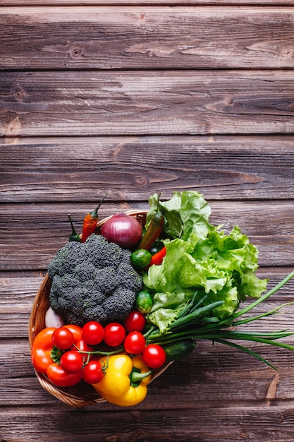 Fresh vegetables and greenery, healthy life and food. broccoli, pepper, cherry tomatoes, chili Free Photo