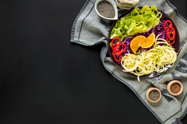 Fresh vegetables salad with ingredients on table cloth Free Photo