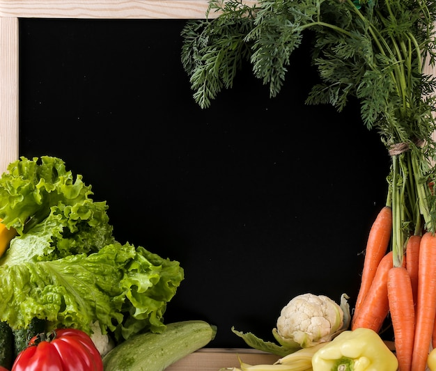 Fresh vegetables with a blackboard Free Photo
