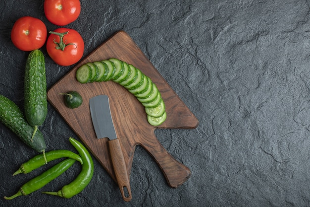 Fresh vegetables on wooden board. tomato cucumber and green pepper. high quality photo Free Photo