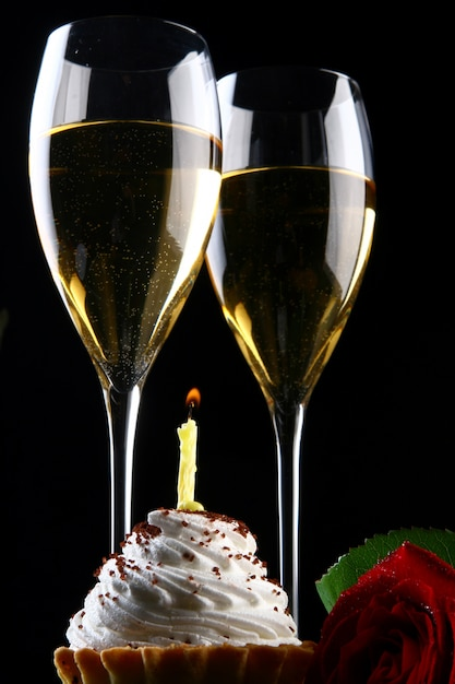 Fresh and very tasty drink and cupcake with candle Free Photo
