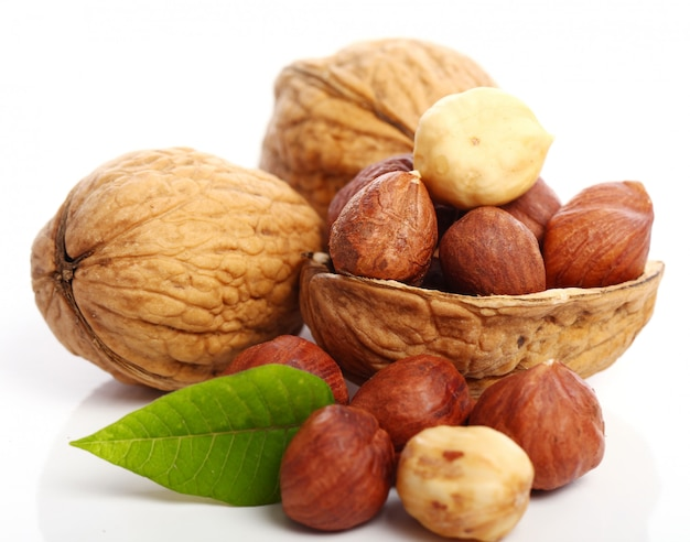 Fresh walnut with leavess and hezelnuts Free Photo