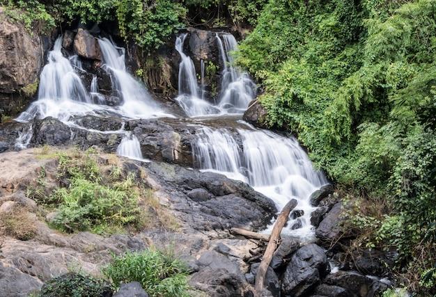 Fresh waterfall from the granite cliff. Premium Photo