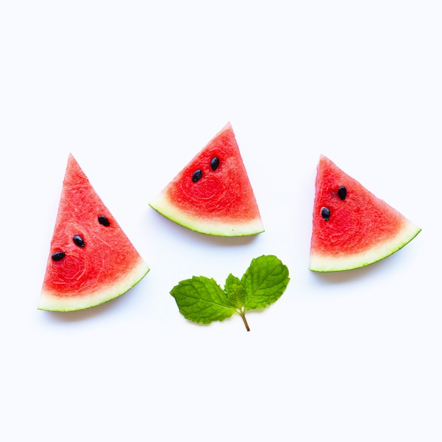 Fresh watermelon slices with mint leaves on white background. Premium Photo