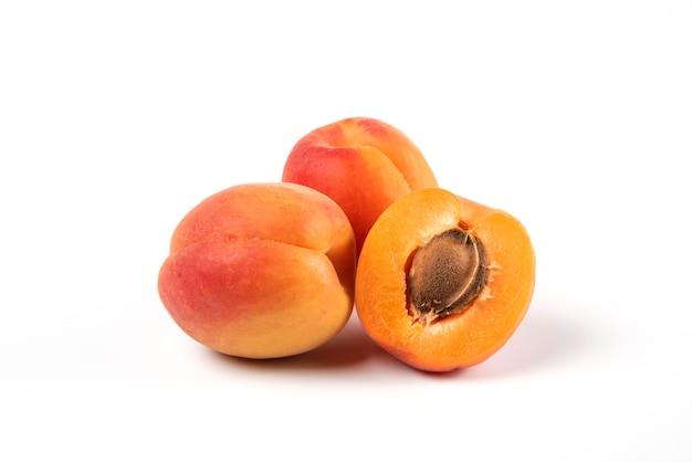 Fresh yellow apricots isolated on white Free Photo