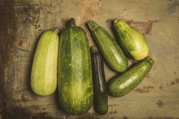 Fresh zucchini or green courgette, farm fresh produce, summer squash, overhead Premium Photo