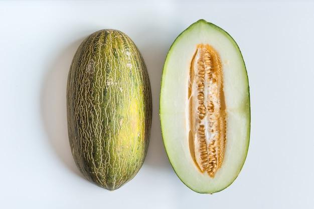 Freshly cut honeydew melon on a white background Free Photo