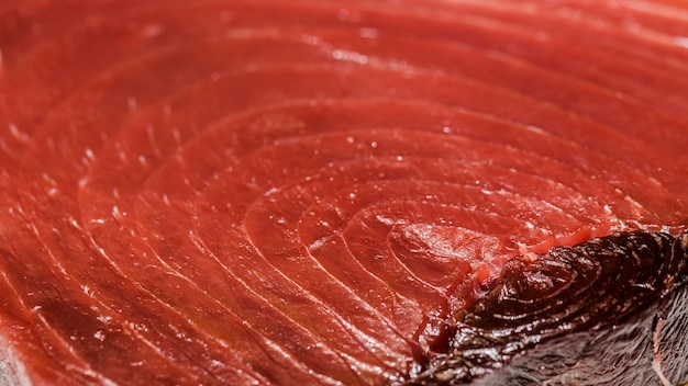 Freshly cut red meat fish in market Free Photo