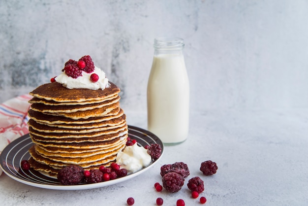 Freshly made pancakes assortment with copy space Free Photo