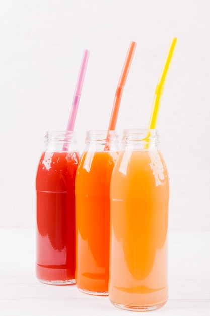 Freshly squeezed juices in bottles Free Photo