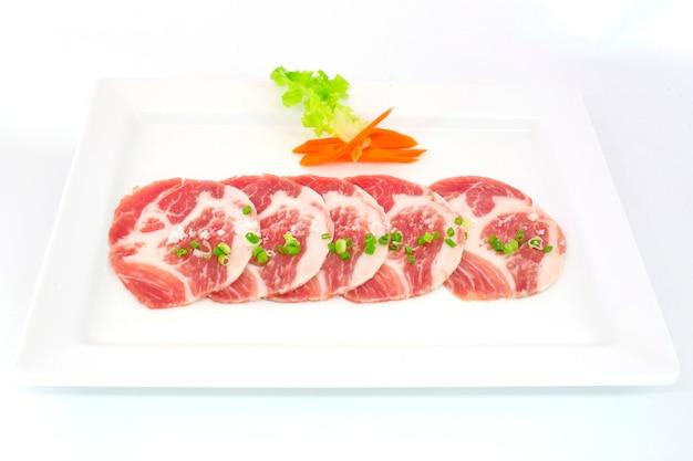 freshness slided pork on white dish for grill photo premium download