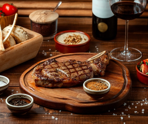 Fried beef steak on wooden board Free Photo