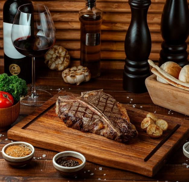 Fried beef steak on wooden board Free Photo