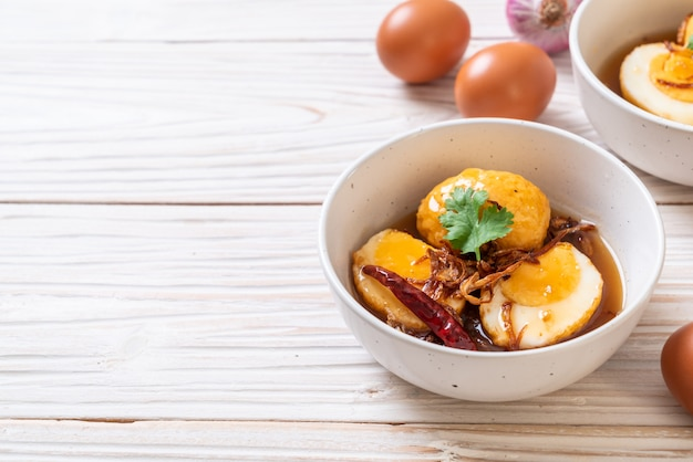 Fried boiled egg with tamarind sauce Premium Photo