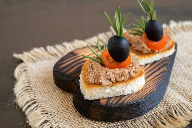 Fried bread with meat pate in the shape of a heart. Premium Photo