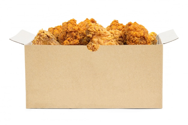 Fried chicken in cardboard box isolated on white background. Premium Photo