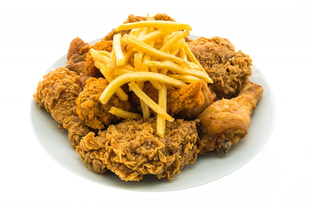 Fried chicken and french fries in white plate Free Photo