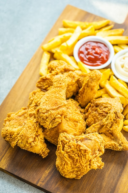 Fried chicken wings with french fries and tomato Free Photo