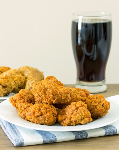 Fried chicken with cola on dining table Free Photo