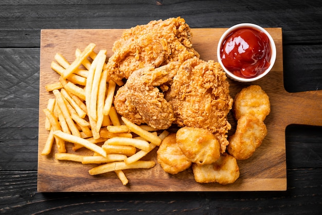 Fried chicken with french fries and nuggets meal Premium Photo