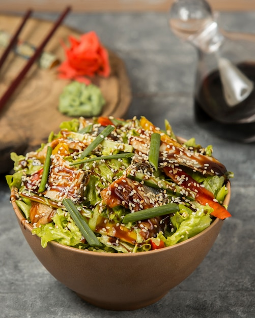 Fried chicken with vegetables and sesame under sauce Free Photo