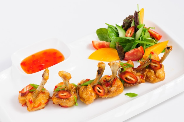 Fried chilli chicken wings Premium Photo
