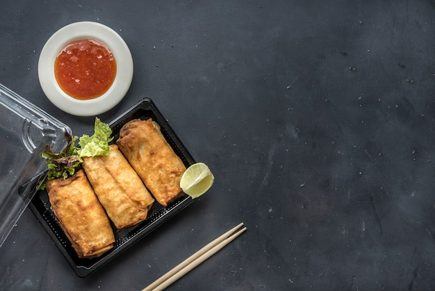 Fried chinese spring rolls with sweet chili sauce Premium Photo