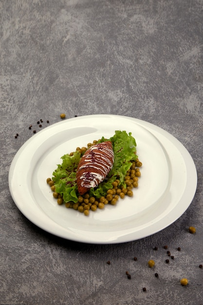 Fried cutlet with green peas Free Photo