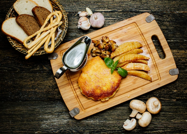 Fried cutlet with potatoes and mushrooms Free Photo