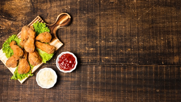 Fried drumsticks with ketchup and copy space Free Photo