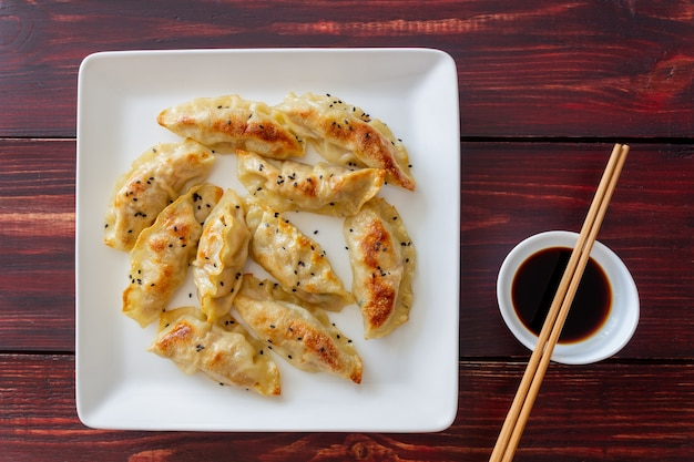 Fried dumplings with soy sauce. gyoza. healthy eating. vegetarian food. Premium Photo